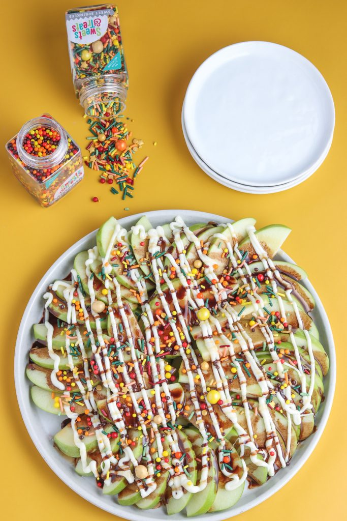 over top view of plate of apple nachos and fall sprinkles