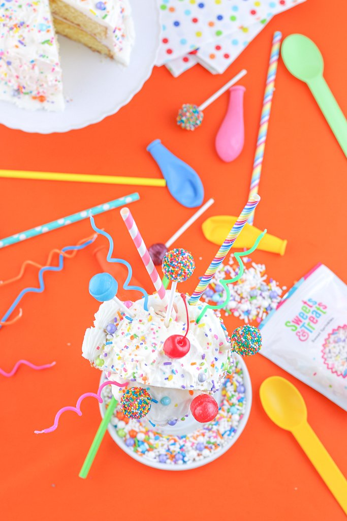 A top down view of the completed tutorial for how to make this birthday cake milkshake in freakshake version! It's cute, colorful, and fun!