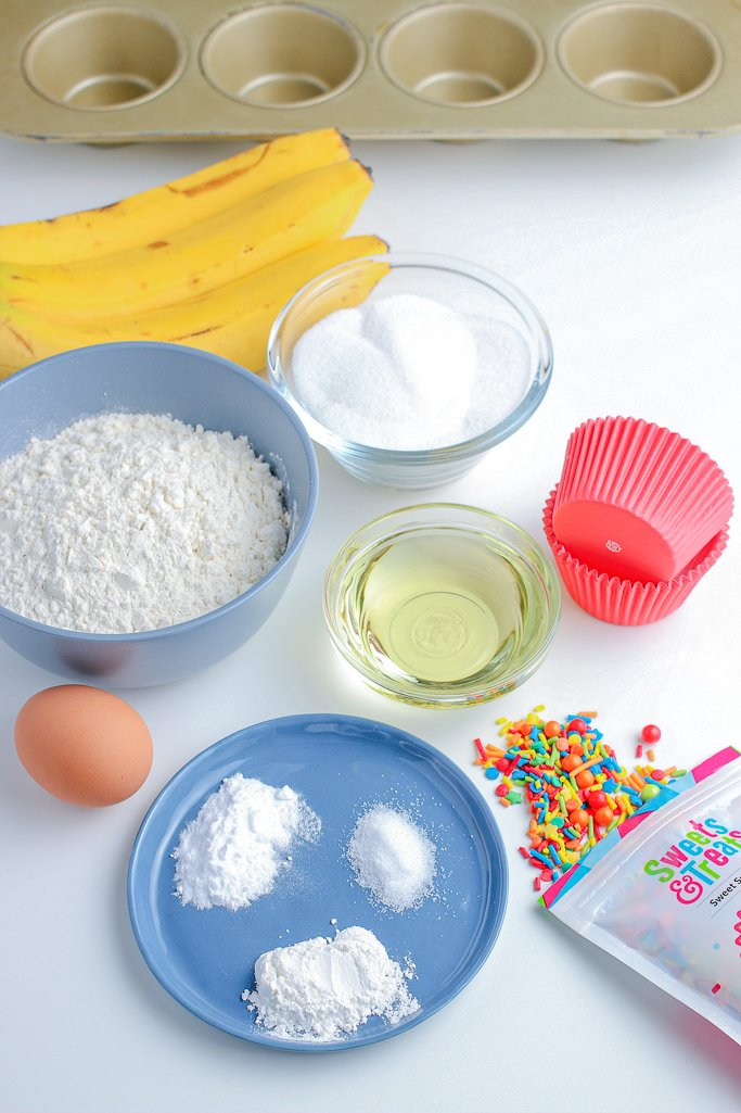 Here we see all of the ingredients for our birthday cake muffins laid out before we begin baking.