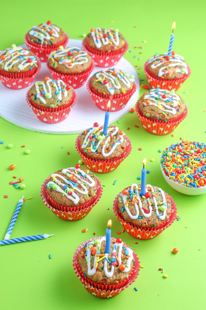 This adorable birthday cake recipe is finished, topped with a drizzle of icing and some sprinkles, and ready to eat.