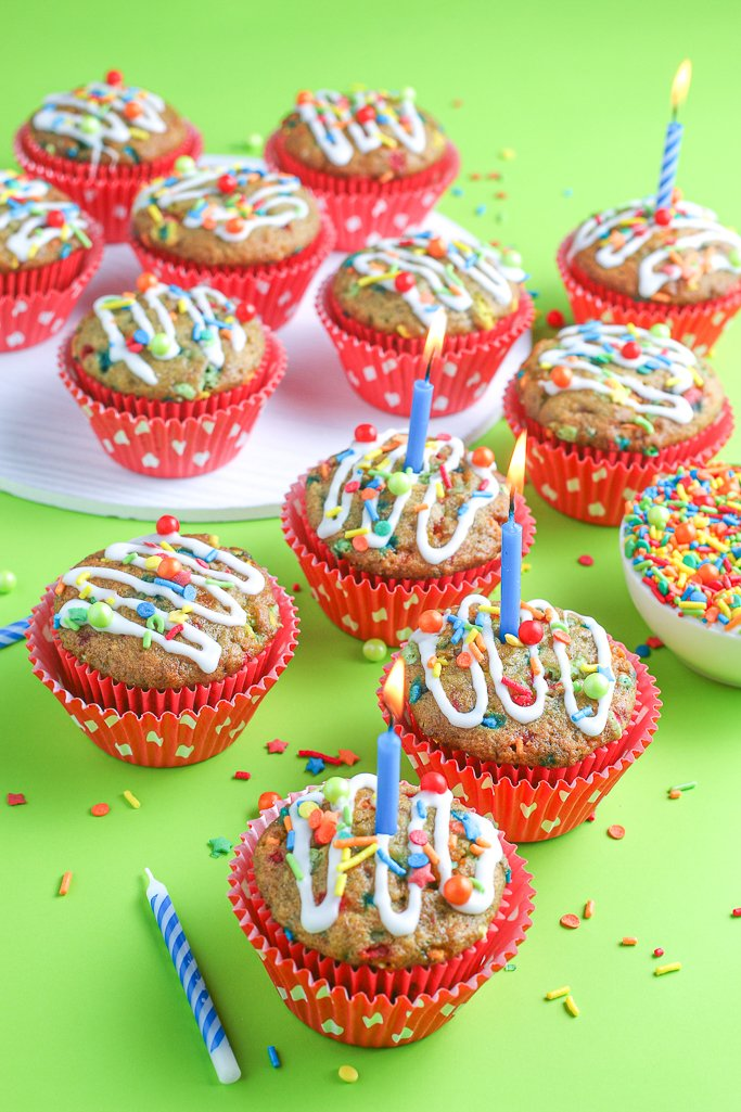 A top down look at the batch of muffins with their sprinkles and icing, ready to share.