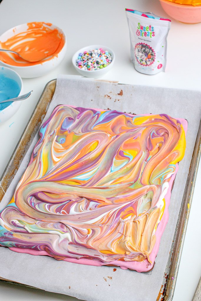 Look how awesome the swirled colors look mixed together as we finish up our how to make birthday cake chocolate bark recipe.