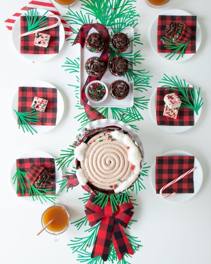 overhead shot of buffalo plaid tablscape with buffalo plaid napkins, ribbon, and our new cupcake liners