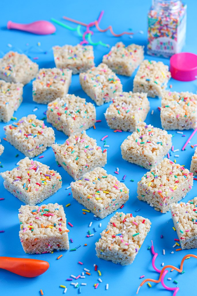A close up view of the cut and finished birthday cake rice krispie treats ready to eat.