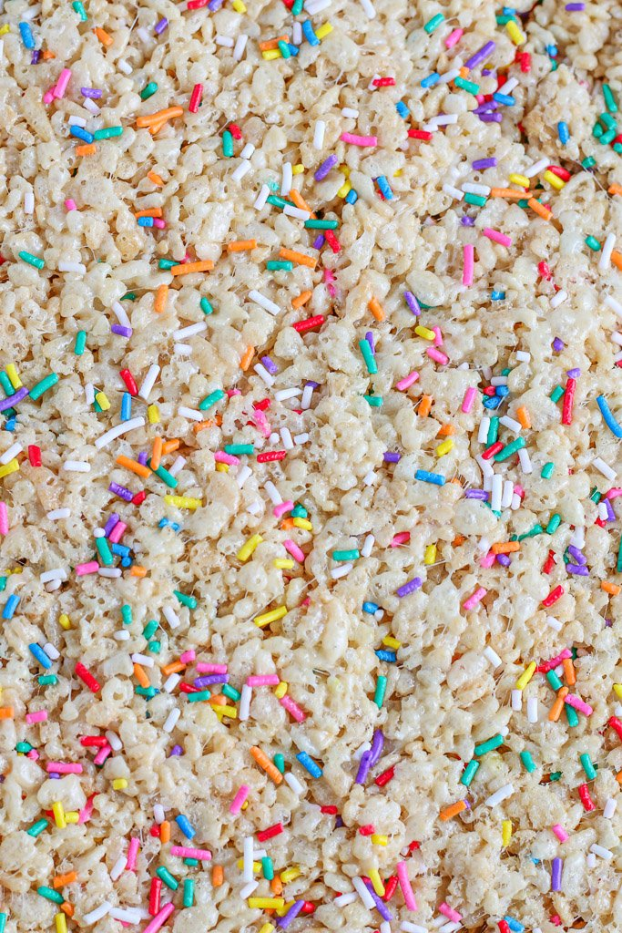 Here we see the cake batter rice krispie treats with sprinkles ready to be cut.