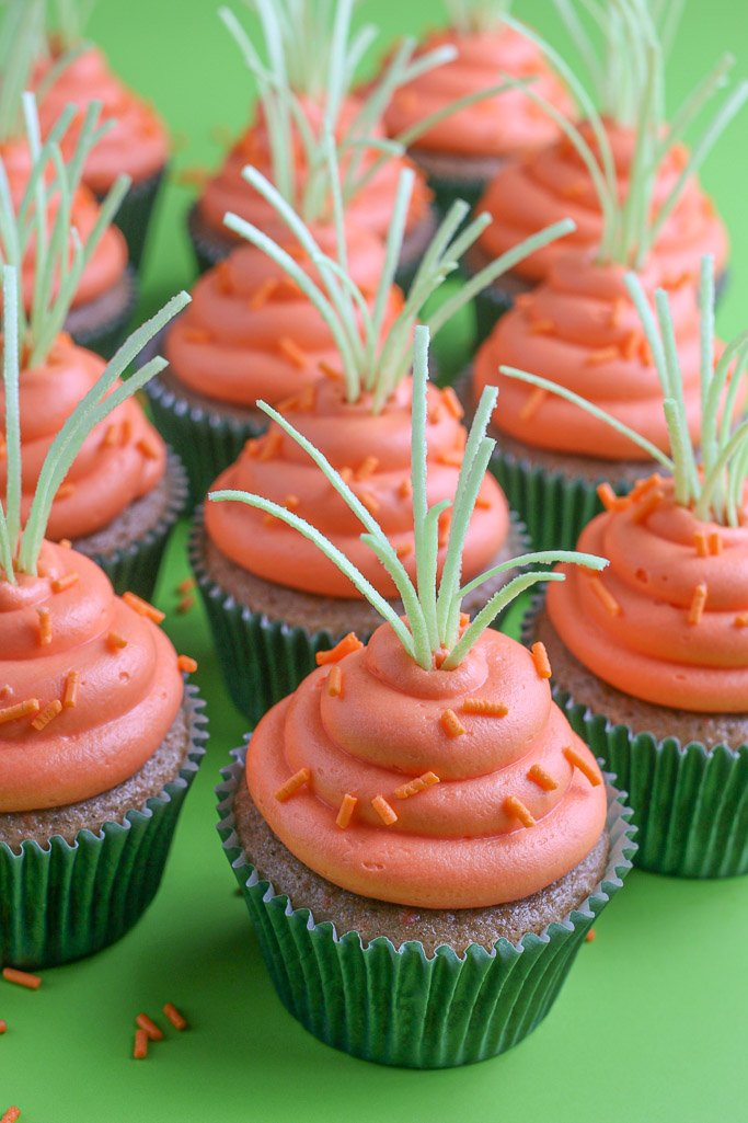 This close up view shows how the tiered orange icing looks like a carrot sticking out of the cake!