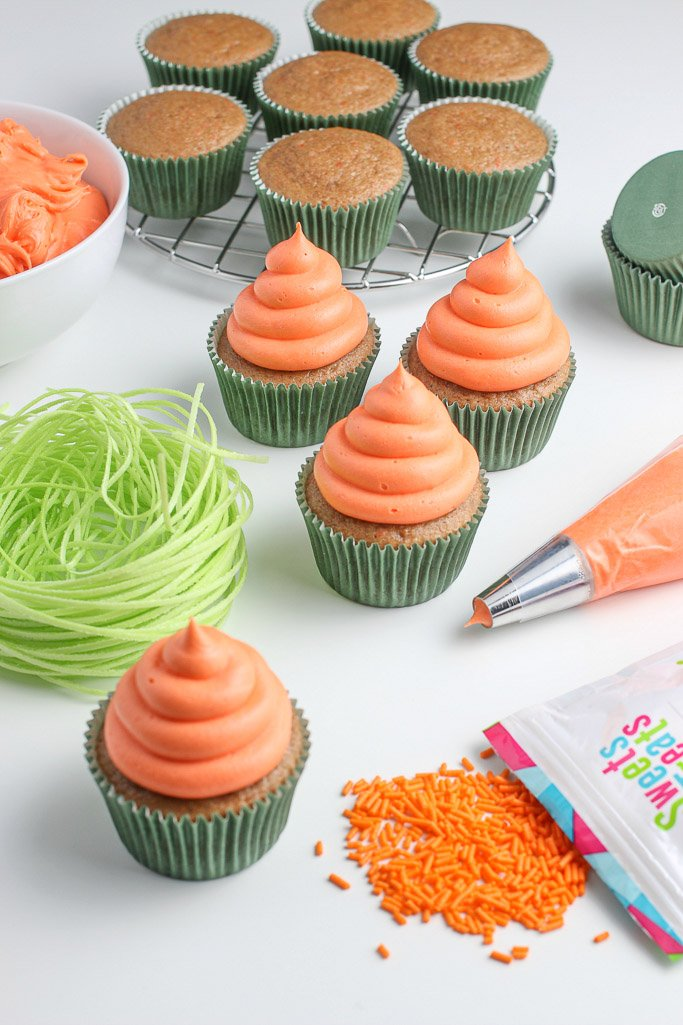 The first step in how to decorate carrot cake cupcakes is to add the orange icing in A spiral to create the ridges!