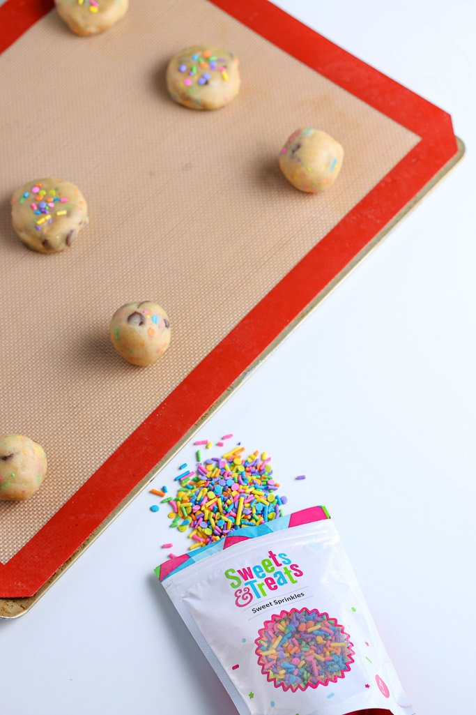 This image shows the dough rolled into balls and placed on silicone baking mats before they go into the oven.