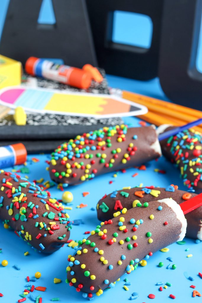 chocolate covered bananas on blue background