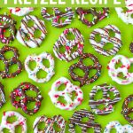 large batch of homemade chocolate covered pretzels recipe on green background