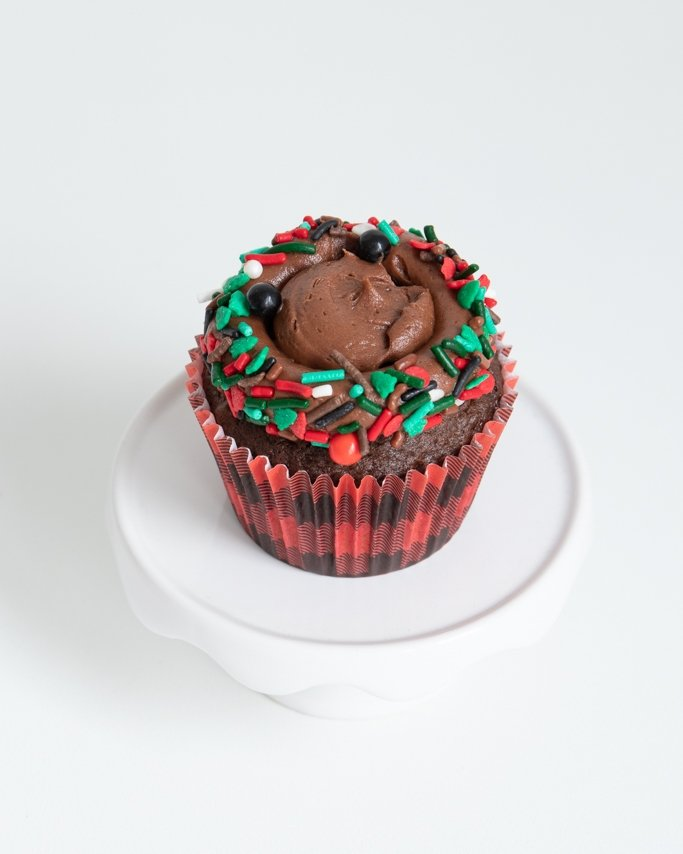 the first step of chocolate pinecone cupcake topper dipped in lumberjack sprinkles