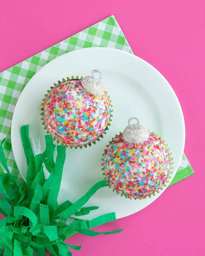 closeup of finished christmas ornament cupcakes with metal hanging loop