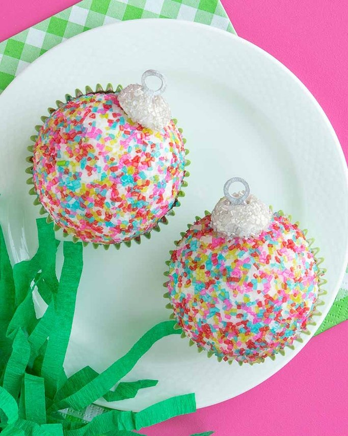 closeup of christmas ornament cupcakes using sugar crystals and silver quin sprinkles