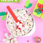puppy chow for Christmas recipe in big white bowl on pink background