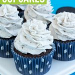 oreo cupcakes recipe with cookies and cream frosting in navy cupcake liners on white dessert platter