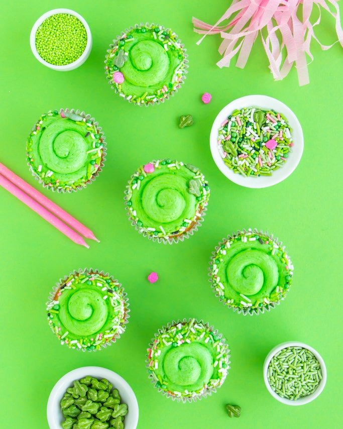 Cactus Party Cupcakes with cactus sprinkles on green background
