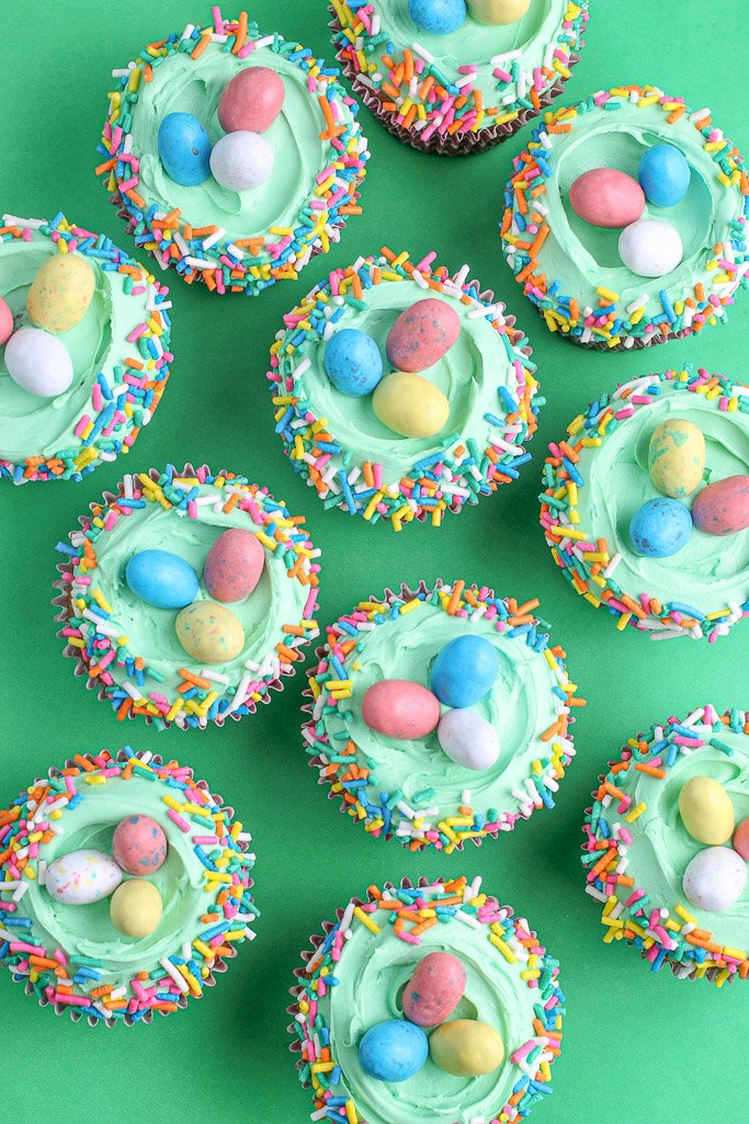 top view of Easter egg cupcakes with Easter jimmies and candy eggs on top