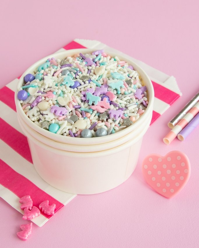 Fairy Tails Unicorn Sprinkles in white treat cup on light pink background