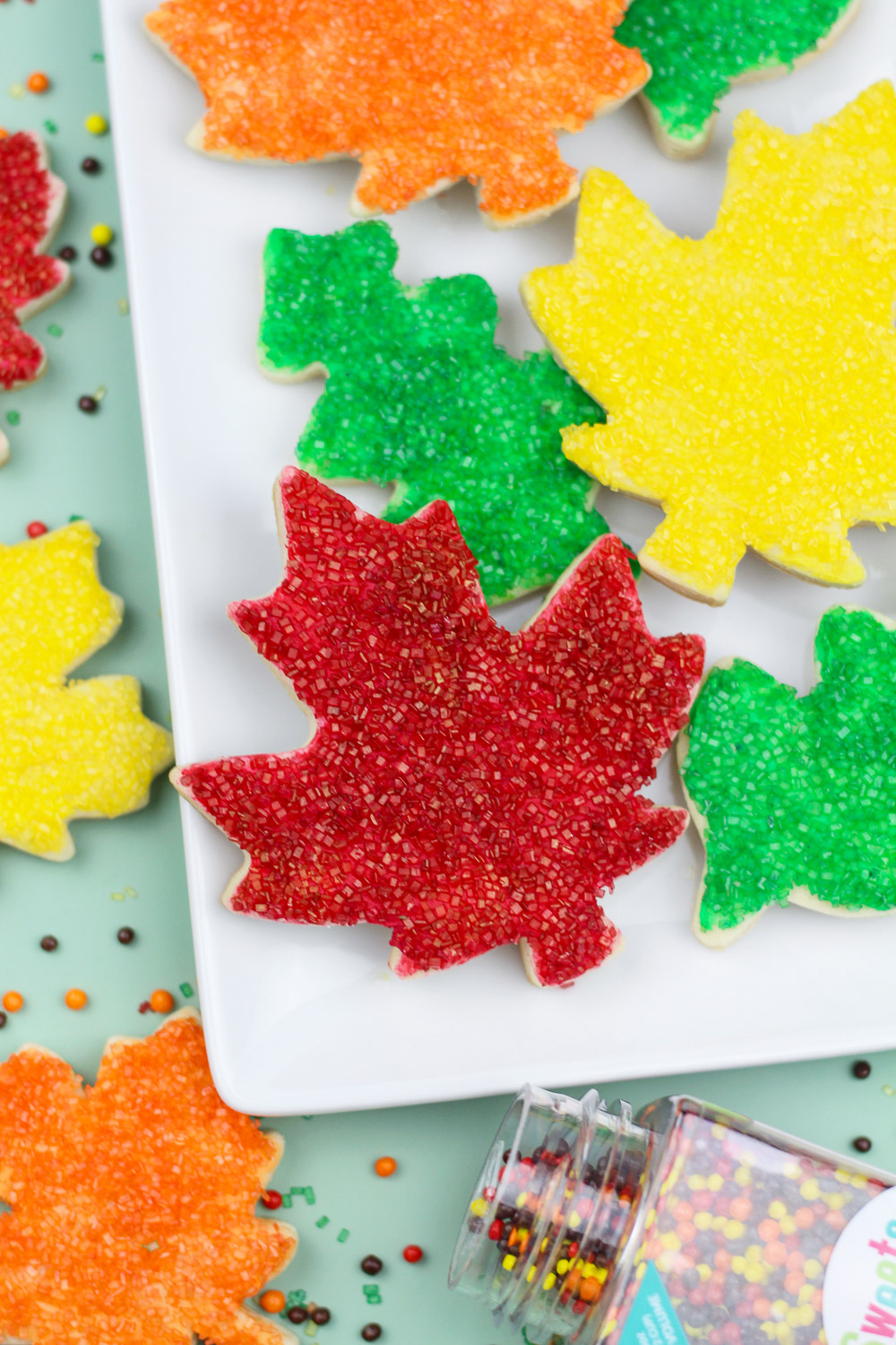 Fall cookies shaped like leaves topped with sugar crystals