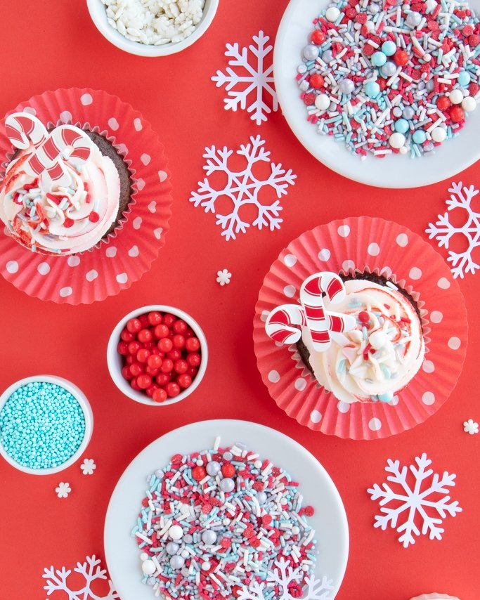 Winter Wonderland Party Ideas - cupcakes, sprinkles on red background