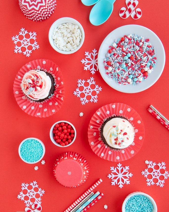 overhead shot of winter wonderland party ideas, winter birthday party ideas on red background