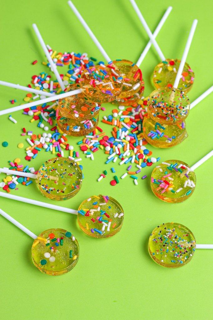 Another view of the finished homemade lollipops with sprinkles of different kinds inside.