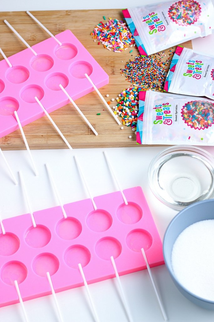 The first thing to do when learning how to make lollipops is put the sticks into our lollipops mold.