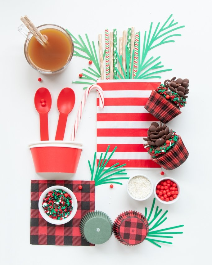 lumberjack party supplies collage with buffalo plaid cupcake liners, apple cider and more