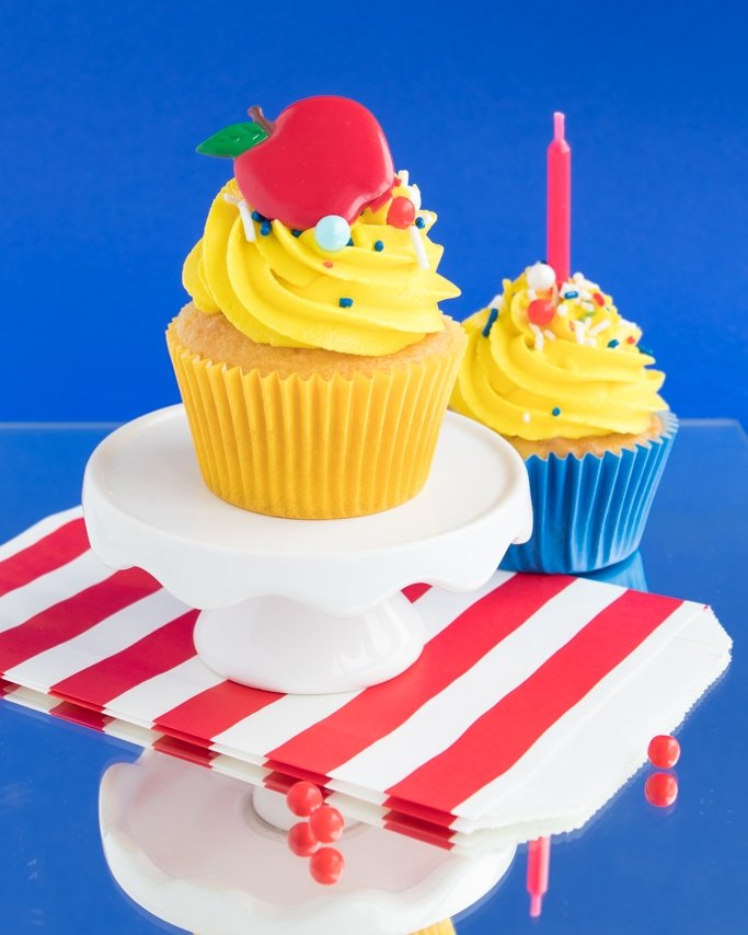 Snow White Birthday Party Ideas - Cupcakes on blue background and red candles