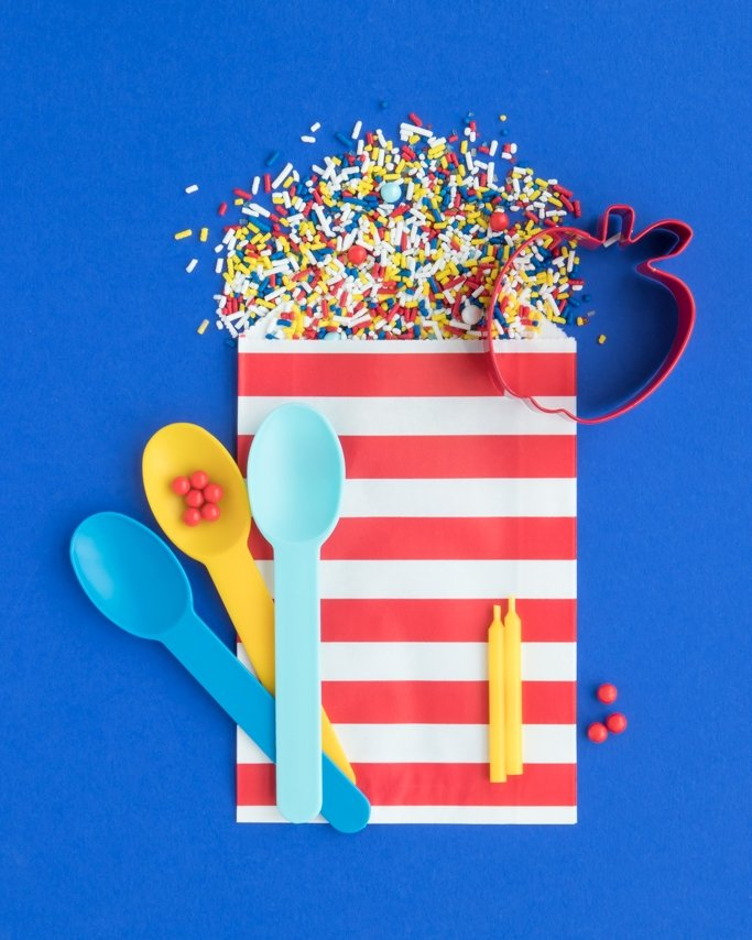 Snow White Party Supplies - Bad Apple Sprinkles spilling out of red striped goodie bag