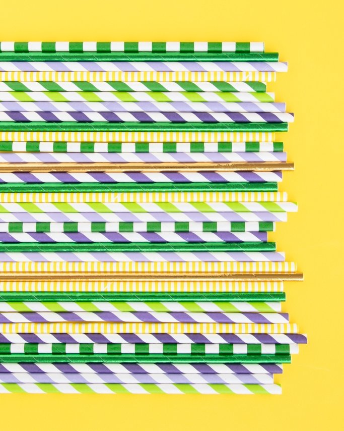 Mardi Gras Paper Straws assorted on yellow background