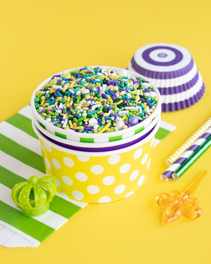 Mardi Gras Sprinkles in ice cream cups on yellow background