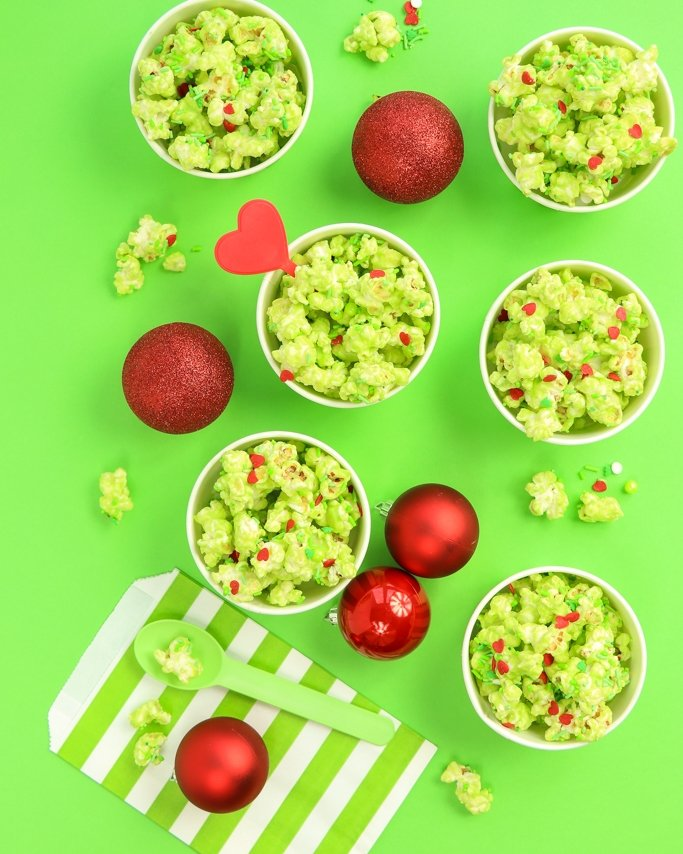 Green popcorn in ice cream cups on green background