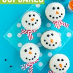 melted snowmen cupcakes with chevron scarves on blue background