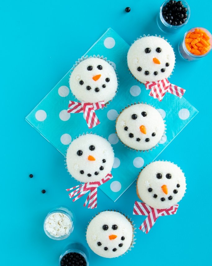group of melting snowman cupcakes from our tutorial covered in sprinkles