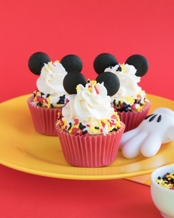 Mickey Mouse Cupcakes on yellow plate and red background