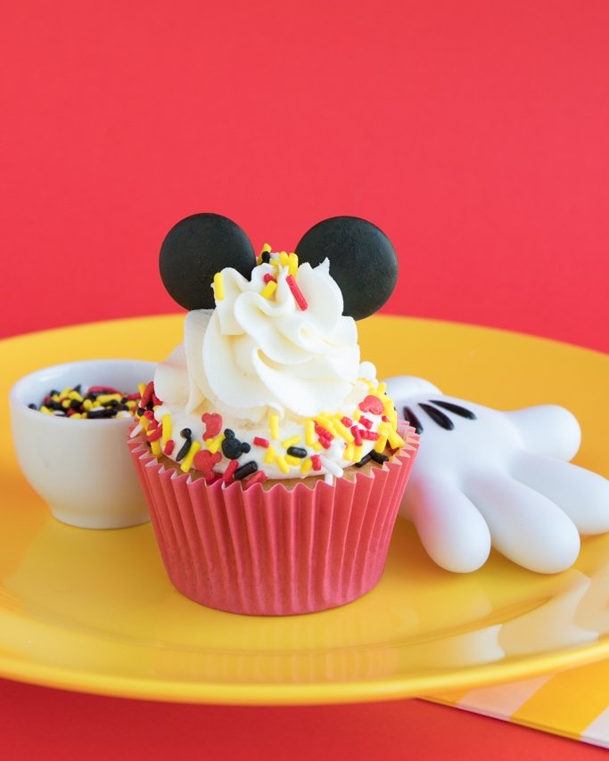 Mickey Mouse Cupcakes Ideas with ears and sprinkles on yellow place and red background