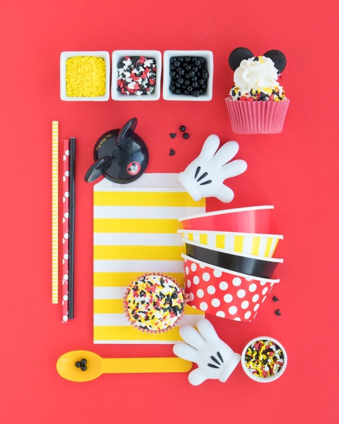 Mickey Mouse Party Supplies collage on red background