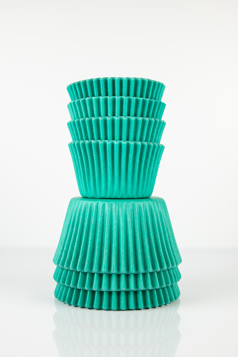 larger size midi cupcake liners stacked on top of standard size baking cups
