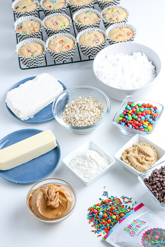 Here the cupcakes are baked and we can see the ingredients needed to make the cookie dough topping laid out ready to be combined.
