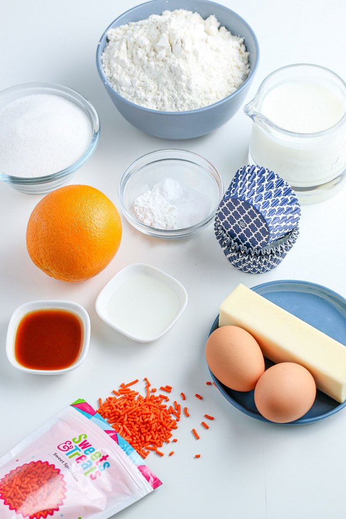 Here we see the ingredients for orange cream cupcakes laid out before we start baking.