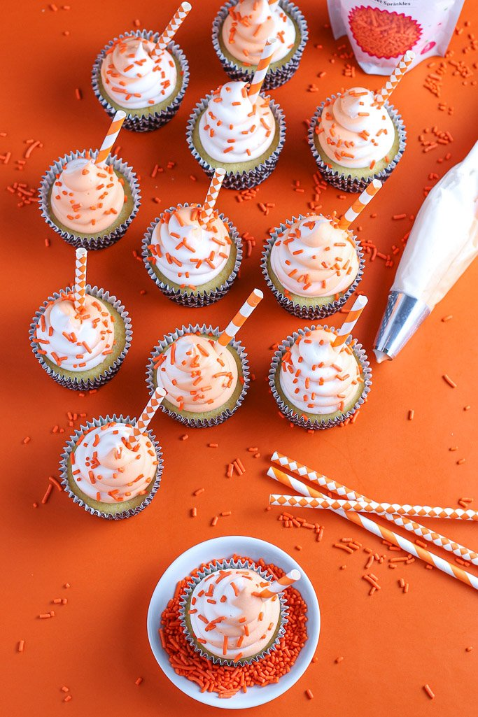 A view from above of the decorated and ready to eat orange creamsicle cupcakes.