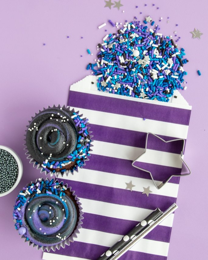 Galaxy Party Ideas + Baking Supplies - sprinkles with silver quin sprinkles and galaxy themed cupcakes