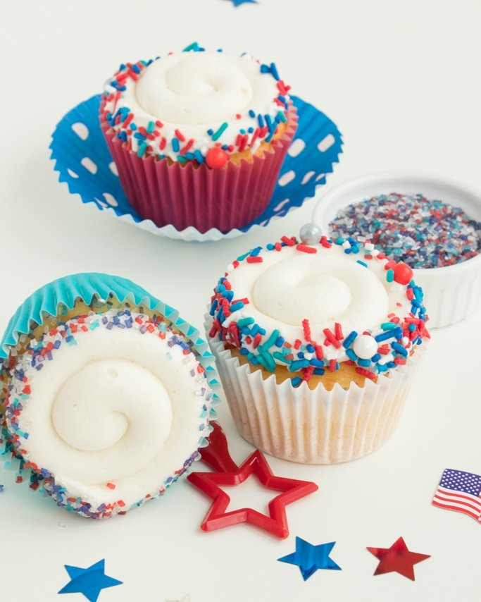 Patriotic cupcakes with red, white, and blue sprinkle mix.