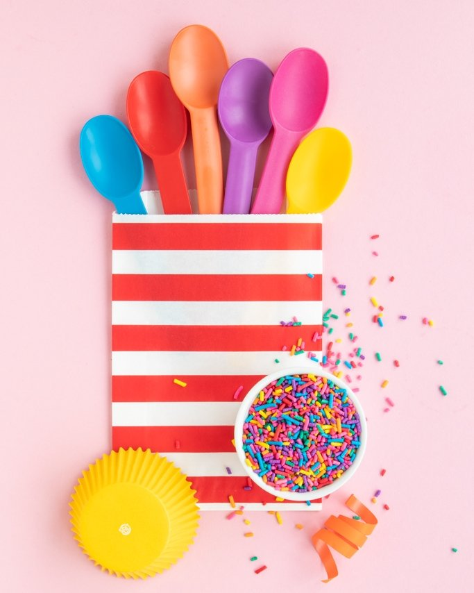 Rainbow party supplies with bold colors