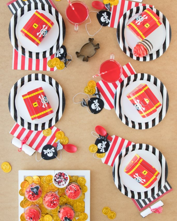 Pirate Party Ideas & Pirate Party Table with favors and gold coins on sand background