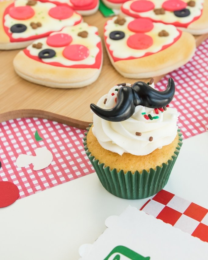 Closeup of pizza party cupcake with pizza sprinkles on top
