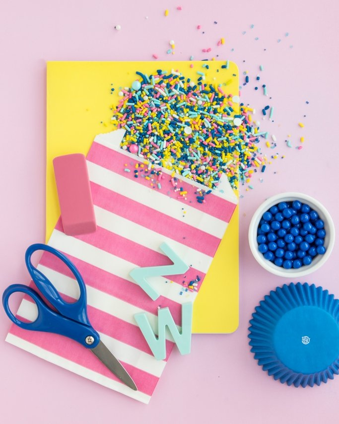 Back To School Party Sprinkles - Modern sprinkles on yellow notebooks and pink background