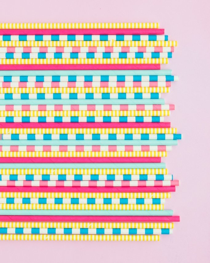 Back To School Party Paper Straws on pink background