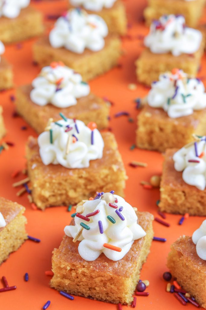 closeup view of pumpkin bars recipe with cream cheese frosting and fall sprinkles
